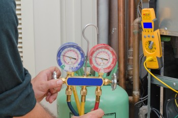 Recharging Coolant during air conditioning maintenance