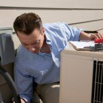 air conditioner technician explaining the difference between HVAC refrigerants