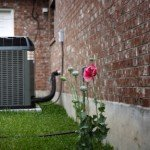 air conditioning system compressor outside a residential home