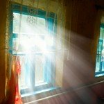 window with sunlight shining through during summer