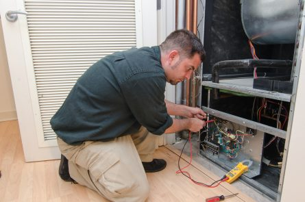 HVAC technician working on a residential heat pump