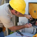 Air conditioning service repairman checking unit