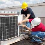 Two AC techs repairing Tampa commercial air conditioner