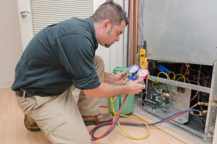 air conditioning technician adding freon